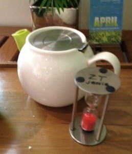 This is a picture of a tea pot and a sand timer from Zen Tara Tea