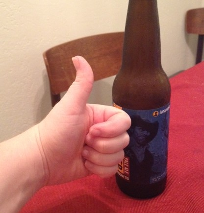 This is a picture of my post-novel completion beer with me giving a thumb's up.