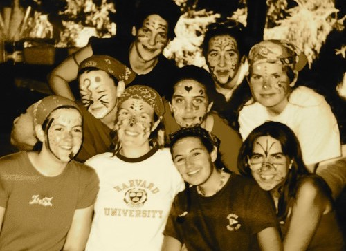 A picture of the author with her fellow campers in the arts and crafts shed right after everyone painted their faces and legs.